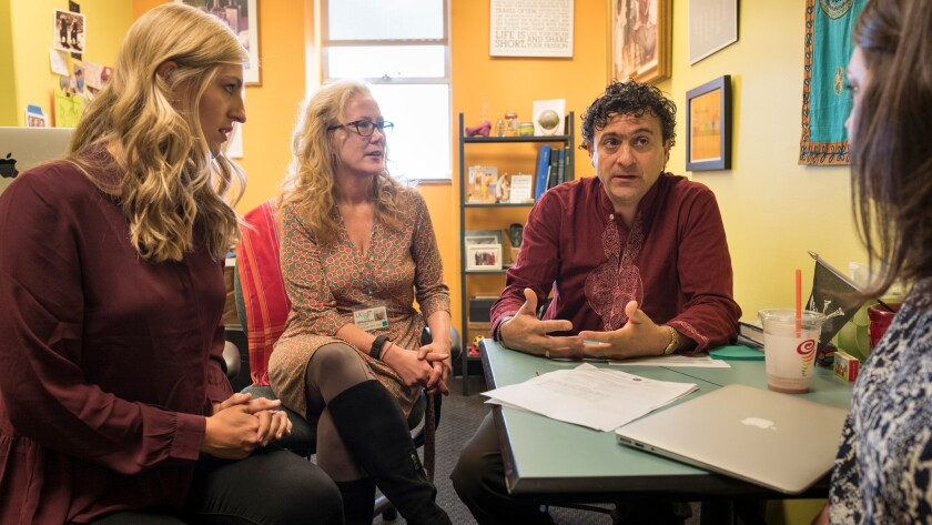 Samantha Erickson, left, of the Wiki Education Foundation; Tina Brock, a dean of the School of Pharmacy at UC San Francisco; and professor Amin Azzam discuss implementing the integration of Wikipeida pages on medical topics with students' work.