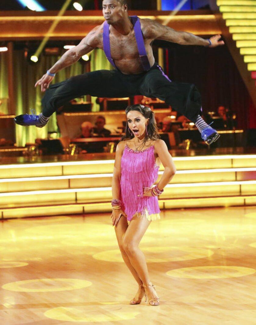 "Jacoby Jones leaps over partner Karina Smirnoff on ""Dancing with the Stars."""