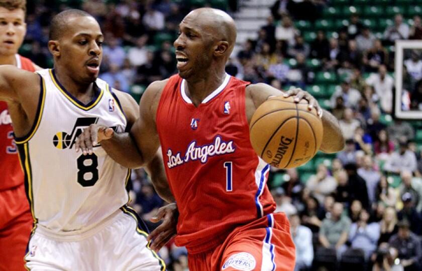 Clippers guard Chauncey Billups tries to drive past Jazz guard Randy Foye on Monday night.