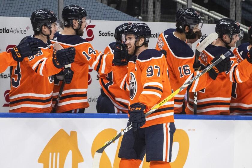 Edmonton Oilers' Connor McDavid (97) celebrates a goal against the Ottawa Senators during first-period NHL hockey game action in Edmonton, Alberta, Friday, March 12, 2021. (Jason Franson/The Canadian Press via AP)