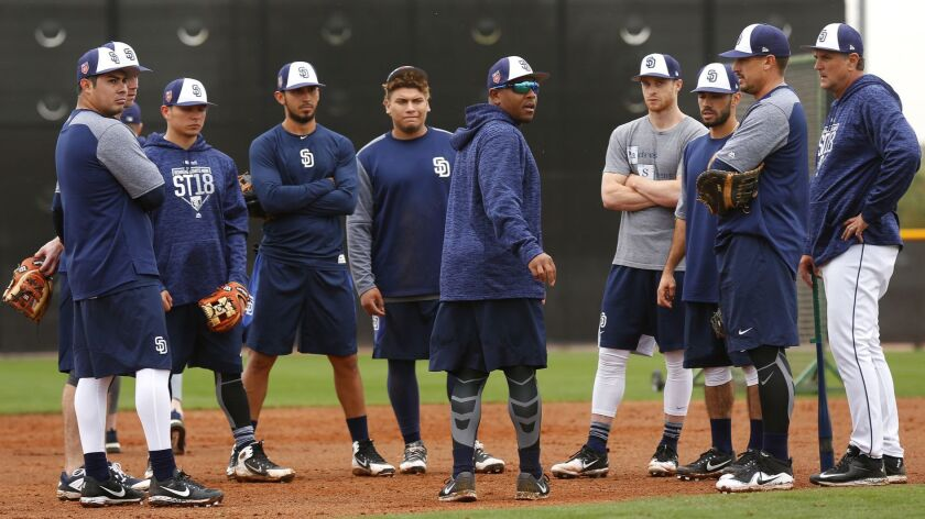 Padres infield coach Josh Johnson talks with infielders during spring training in Peoria on Feb. 14, 2018.