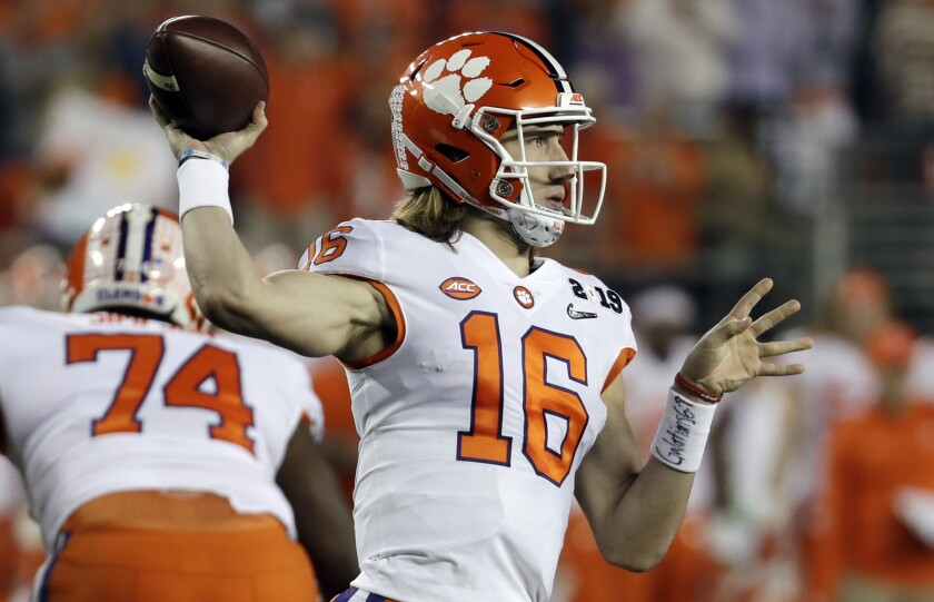 Clemson's Trevor Lawrence throws during the first half of College Football Playoff title game against Alabama in January.