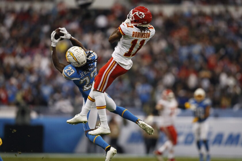Chargers strong safety Rayshawn Jenkins intercepts a pass intended for Kansas City Chiefs wide receiver Demarcus Robinson.