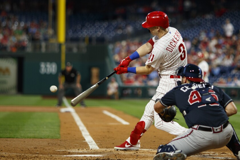 Philadelphia Phillies' Corey Dickerson hits a two-run home run off Atlanta Braves starting pitcher Max Fried during the first inning of a baseball game, Tuesday, Sept. 10, 2019, in Philadelphia. (AP Photo/Matt Slocum)