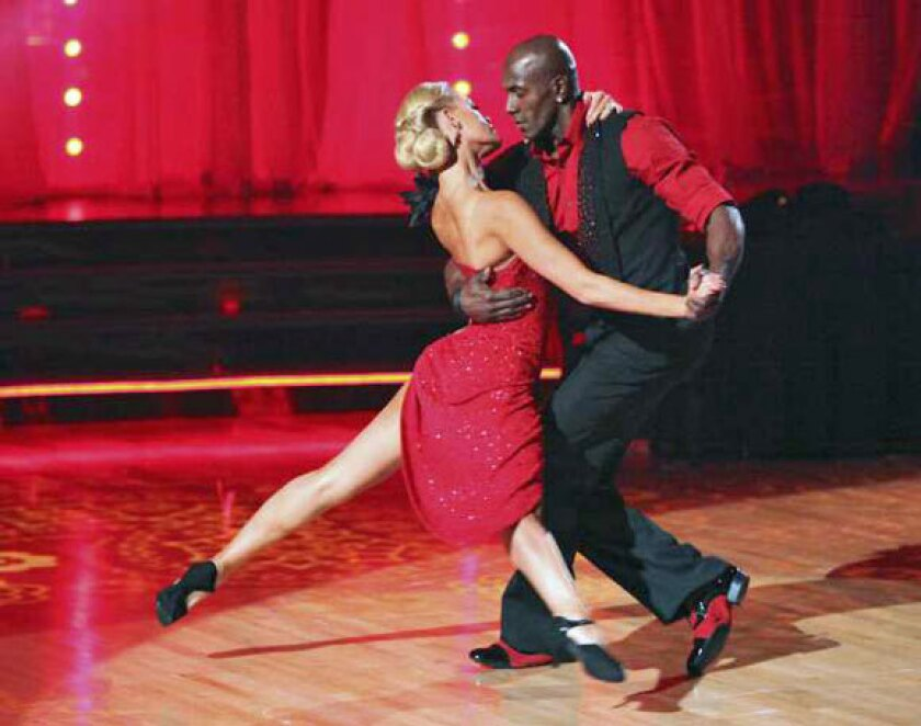"""Donald Driver performs with partner Peta Murgatroyd compete during Week 5 of """"Dancing With the Stars."""""""