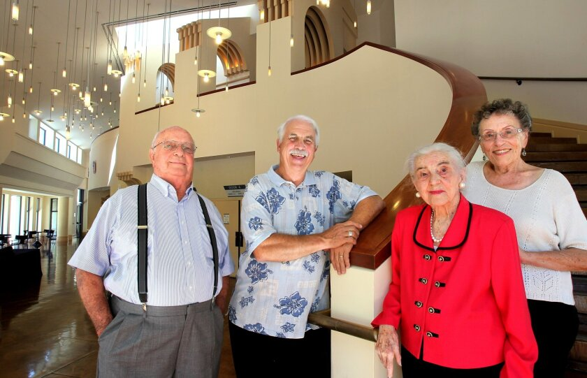 Portrait of members of the Hidden Valley Community Concert Association in the lobby of the Center Theater at the California Center for the Arts, LtoR: Hal Johnson, Dennis Tomlinson (Artistic Director), Eileen Menees, and Dorris Kingsbury.