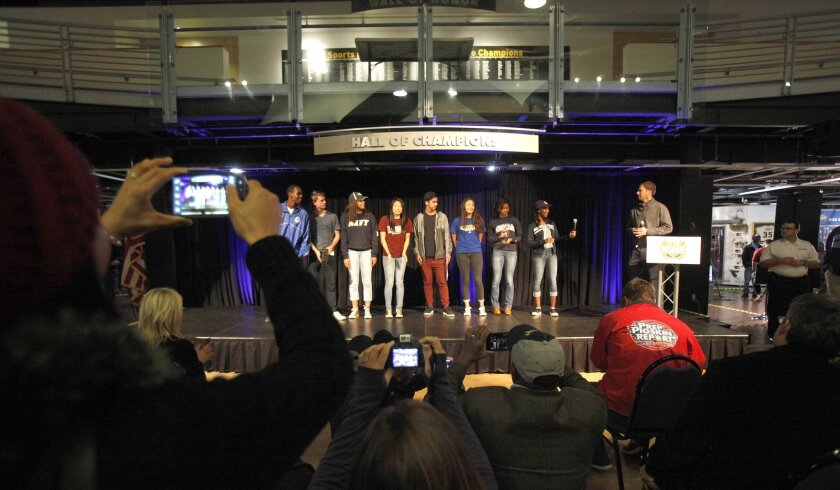 High school athletes line up to announce their college plans during Wednesday's event at the Hall of Champions.
