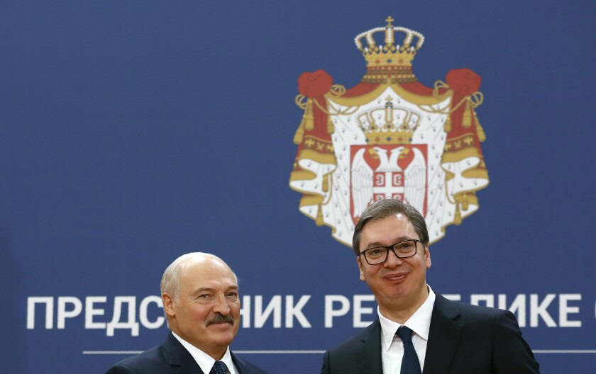 Belarus President Alexander Lukashenko, left, poses with his Serbian counterpart Aleksandar Vucic after a press conference at the Serbia Palace in Belgrade, Serbia, Tuesday, Dec. 3, 2019. Lukashenko is on a two-day official visit to Serbia.(AP Photo/Darko Vojinovic)