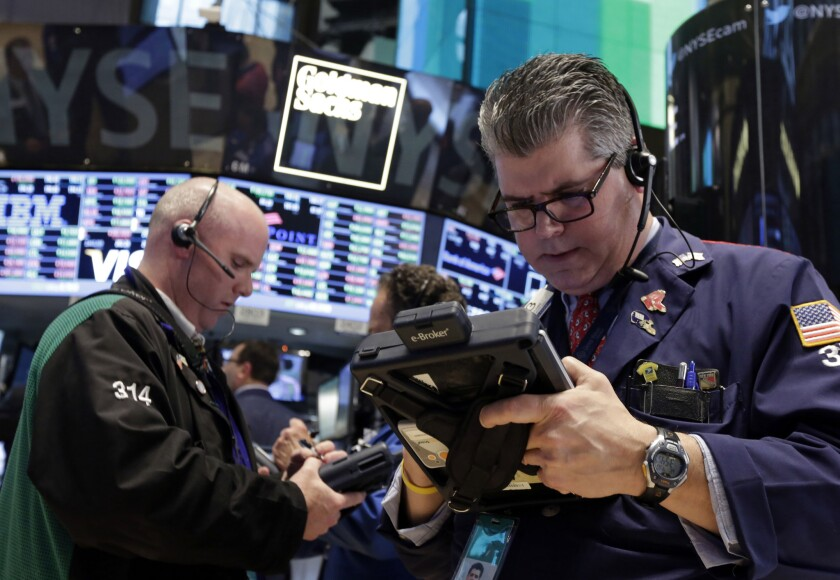 Stocks fell early Wednesday after the World Bank slashed its global economic forecast.