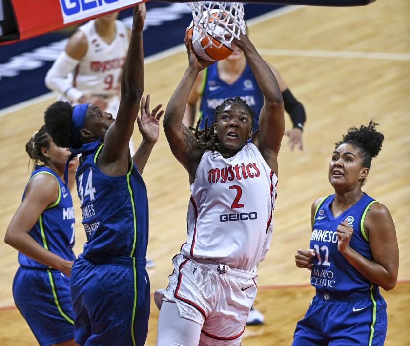 Washington Mystics forward Myisha Hines-Allen (2) drives against Minnesota Lynx center Sylvia Fowles (34) during a WNBA basketball game Tuesday, June 8, 2021, in Washington. (Jonathan Newton/The Washington Post via AP)