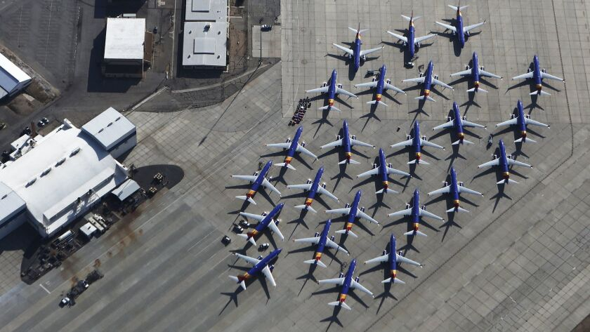 Grounded Boeing 737 Max planes, with Southwest Airlines paint jobs, are parked in Victorville, Calif.