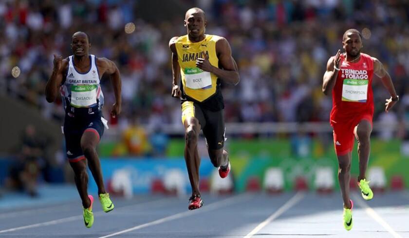 Usain Bolt (c) podría coronarse tricampeón olímpico en los 100 metros...