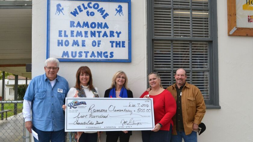 Ramona Elementary Principal Pixie Sulser, center, says the $500 Ramona Chamber of Commerce Educational Grant will support the school's Character Education Program.