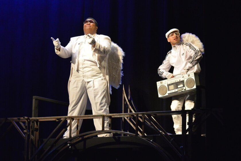 "Willie Green (left) as Archangel Michael and Edwin Frank Ortiz as Archangel Gabriel in ""La Pastorela de Inspiración."""