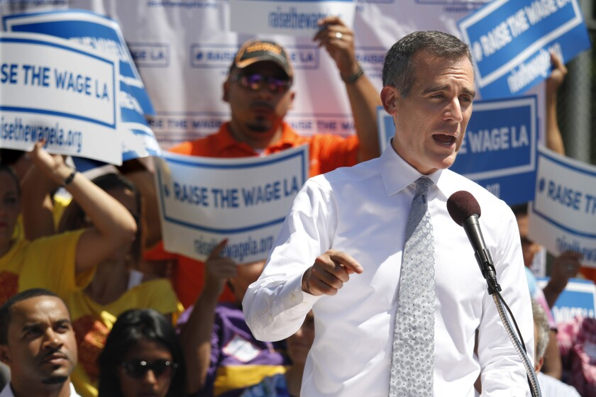 Mayor Eric Garcetti announces his plan to raise the minimum wage in Los Angeles on Sept. 1.