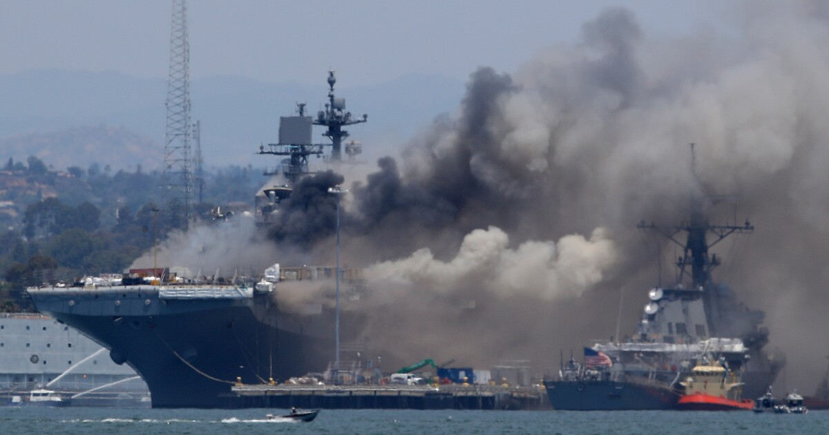 Navy charges sailor with fire that destroyed warship