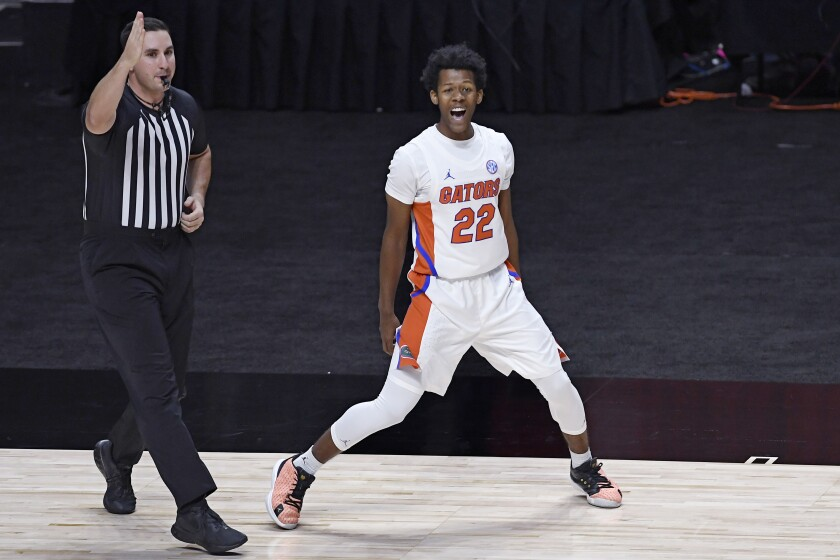 Florida's Tyree Appleby celebrates his basket putting Florida ahead for the first time in the game in the second half of an NCAA college basketball game against Army, Wednesday, Dec. 2, 2020, in Uncasville, Conn. (AP Photo/Jessica Hill)