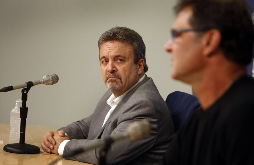 Dodgers general manager Ned Colletti, left, and Dodgers manager Don Mattingly speak to the media on October 21.
