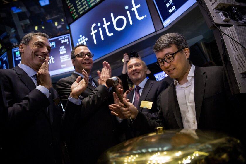 Fitbit Chief Executive James Park rings a ceremonial bell for the company's IPO debut on the floor of the New York Stock Exchange.