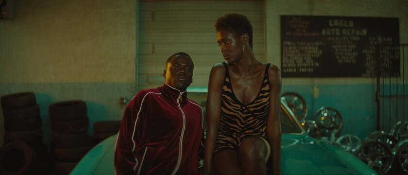 "Slim (Daniel Kaluuya) and Queen (Jodie Turner-Smith) in the movie ""Queen & Slim."""