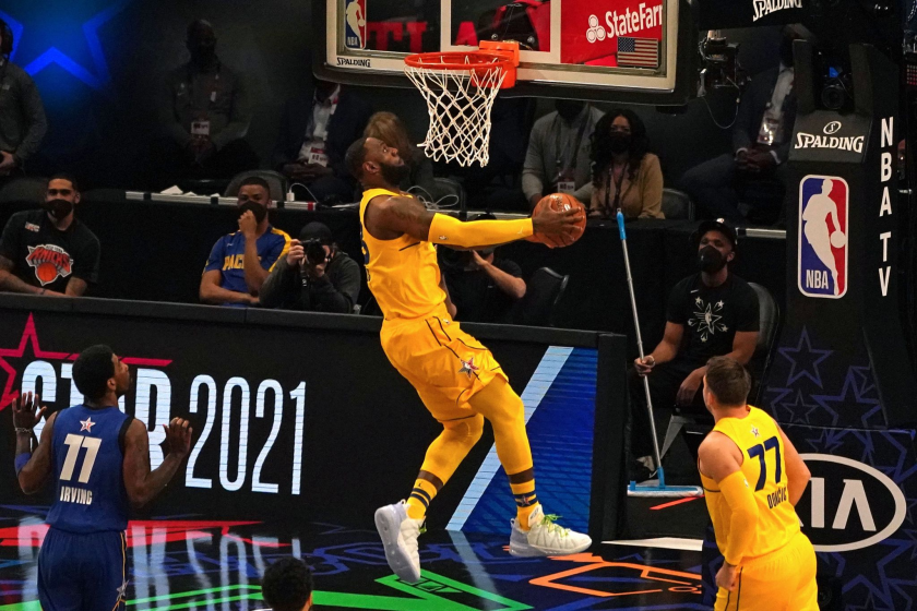 LeBron James dunks during Team LeBron's 170-150 victory over Team Durant at the NBA All-Star Game in Atlanta on Sunday.