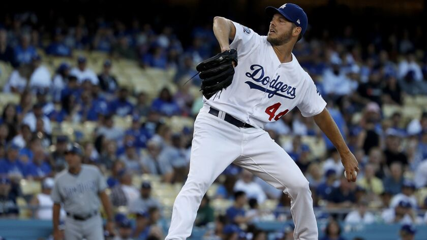 LOS ANGELES, CALIF. - SEP. 22, 2018. Dodger starter Rich Hill drelivers a pitch against the Padres