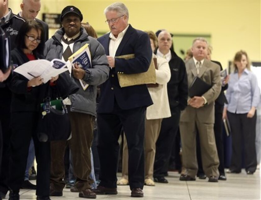 In this Thursday, April 11, 2013, photo, people wait in line before the Dr. King Career Fair at the Empire State Plaza Convention Center in Albany, N.Y. The government issues the April jobs report on Friday, May 3, 2013. (AP Photo/Mike Groll)