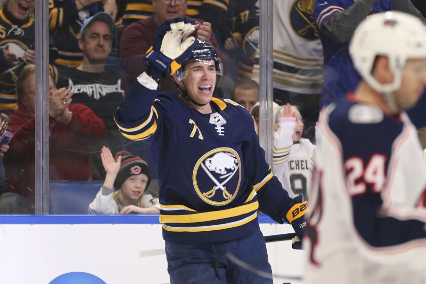 Buffalo Sabres forward Evan Rodrigues (71) celebrates his goal during the first period of an NHL hockey game against the Columbus Blue Jackets, Saturday, Feb. 1, 2020, in Buffalo, N.Y. (AP Photo/Jeffrey T. Barnes)