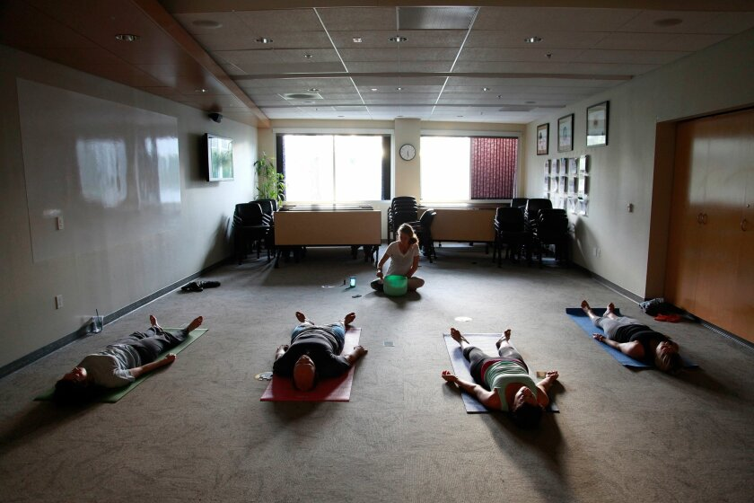 SAN DIEGO, CA-OCTOBER 21, 2015: | Twice a week, CBIZ employees have the option to participate in a yoga class as one of their work benefits. | (Misael Virgen/ San Diego Union-Tribune)
