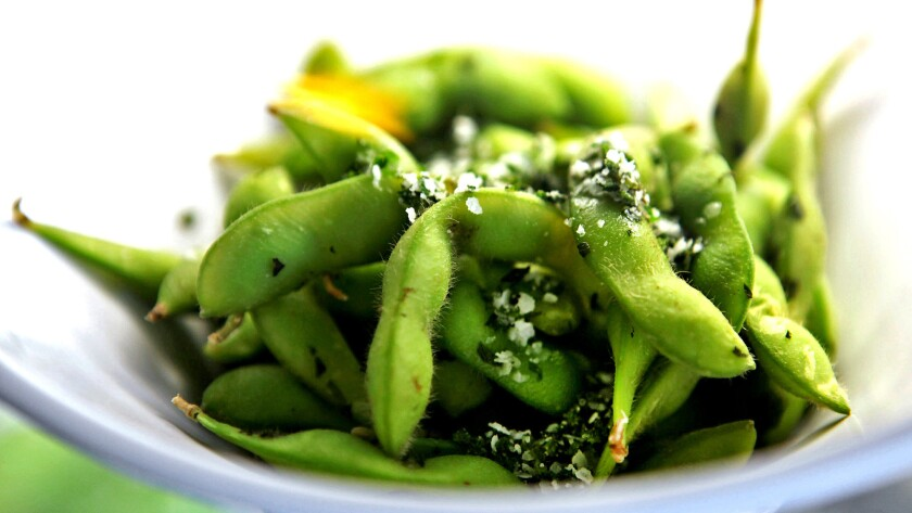Researchers say eating soy, such as edamame, as a teen can help prevent breast cancer later.