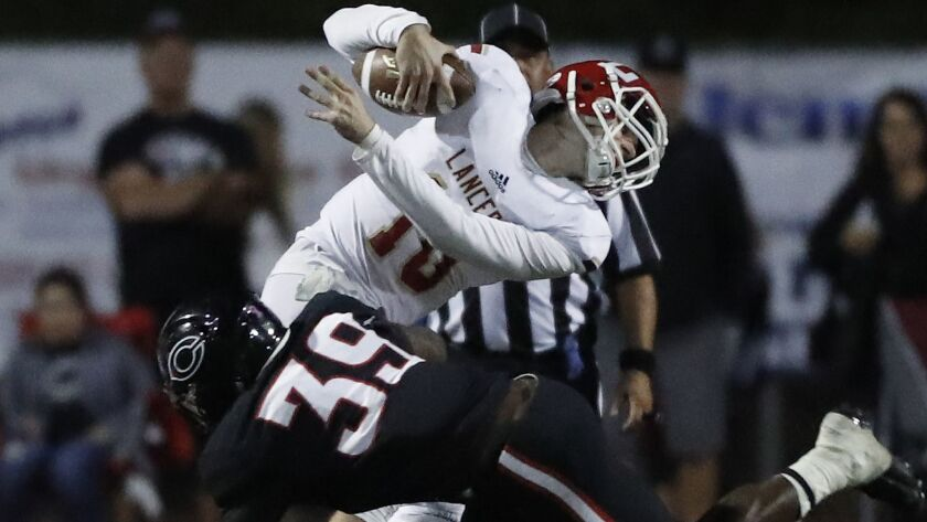 Corona Centennial linebacker Kevin Foreman Jr. brings Orange Lutheran quarterback Jack Fierro down for a sack in the fourth quarter.