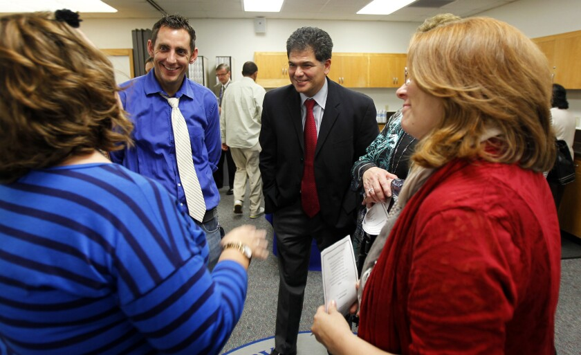 Chula Vista Elementary District Superintendent Francisco Escobedo (right) talks with teachers.