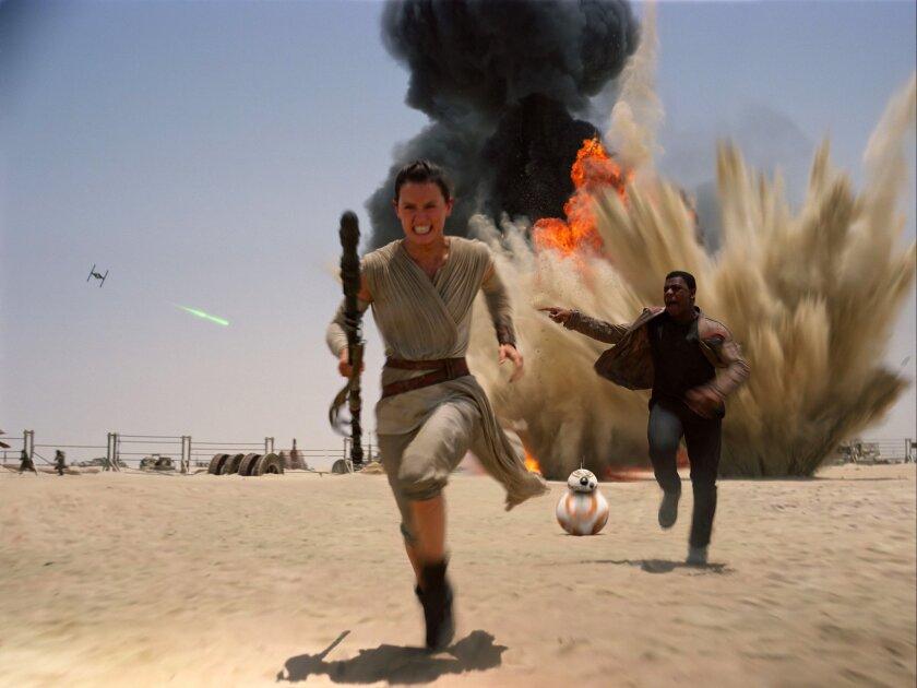 "Daisey Ridley and John Boyega in ""Star Wars: The Force Awakens."""