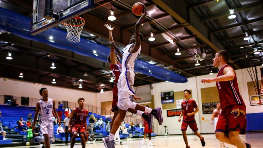 San Diego's Emanwel Henry jumps for a dunk but is fouled in the process by Steele Canyon in the fourth quarter.