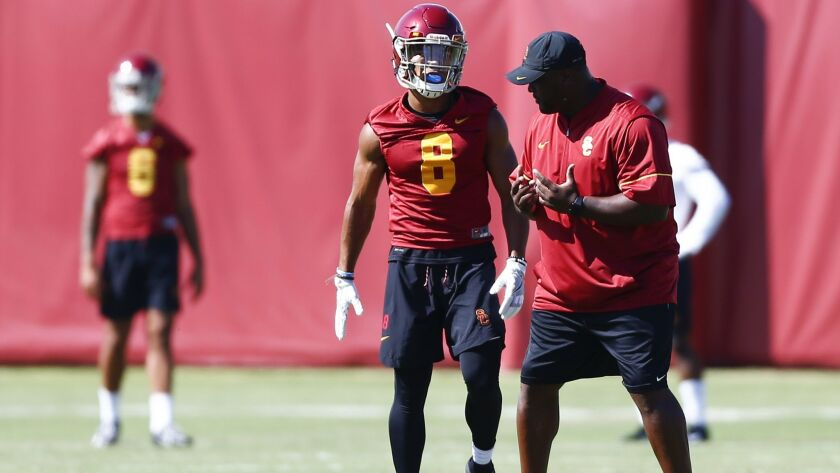 LOS ANGELES, CALIF. - AUGUST 03: Trojans Offensive Coordinator Tee Martin talks with USC Trojan Amon