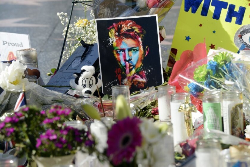 A memorial for David Bowie grows at his star on the Hollywood Walk of Fame.