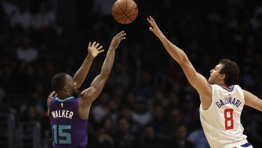 Charlotte's Kemba Walker shoots over the Clippers' Danilo Gallinari during the first half on Tuesday.