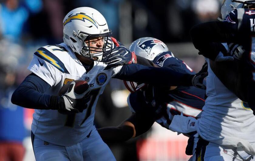 Los Angeles Chargers quarterback Philip Rivers (L) is grabbed by New England Patriots lineman Adam Butler (R) in the second quarter of their AFC Divisional Playoff game at Gillette Stadium in Foxborough, Massachusetts, USA, 13 January 2019. EFE/EPA/JOHN CETRINO