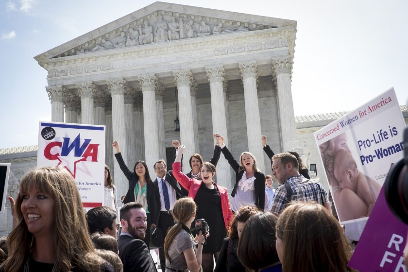 The legal team representing Hobby Lobby Stores Inc. celebrates outside the Supreme Court. A federal judge turned part-time blogger has decided to take his own advice and shut up for a while.