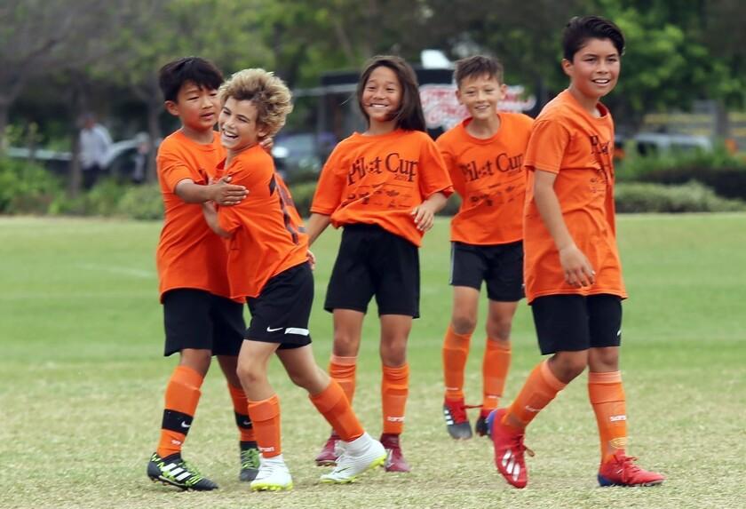 Davis players celebrate after a score during Pomona Elementary School against Davis Elementary Schoo