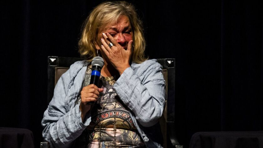 Roseanne Barr wipes away tears during a discussion on atonement and repentance on the eve of Yom Kippur at the Saban Theater.