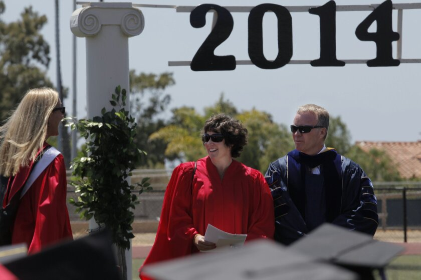 San Diego schools Superintendent Cindy Marten said the initial rollout of the new discipline strategy is crucial for the program to succeed. Marten, center, is pictured at La Jolla High School graduation in June.