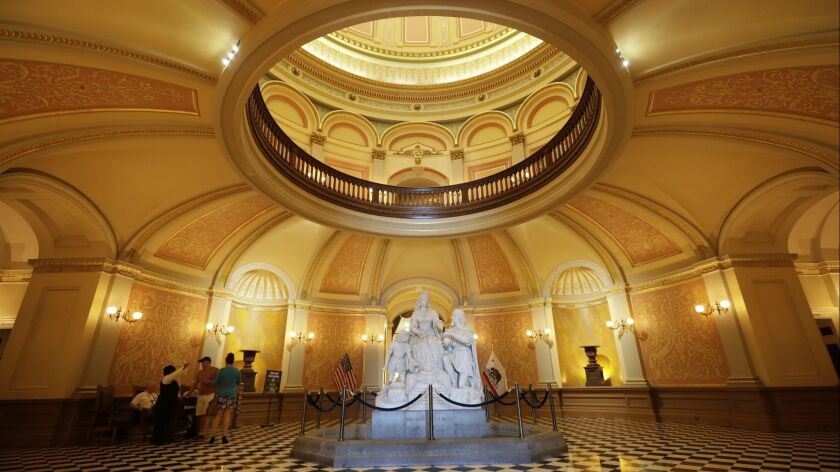 """SACRAMENTO, CALIF. - OCTOBER 26, 2017: The statuary, """"Columbus' Last Appeal to Queen Isabella,"""" gree"""