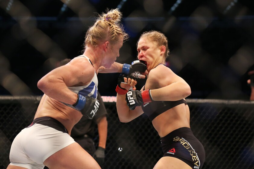 Holly Holm punches Ronda Rousey during their championship bout at UFC 193 in Melbourne, Australia. UFC leadership says Holm's next fight will be a rematch with Rousey. Holm's camp wanted a fight against Miesha Tate while Rousey recovered from her first fight against Holm.
