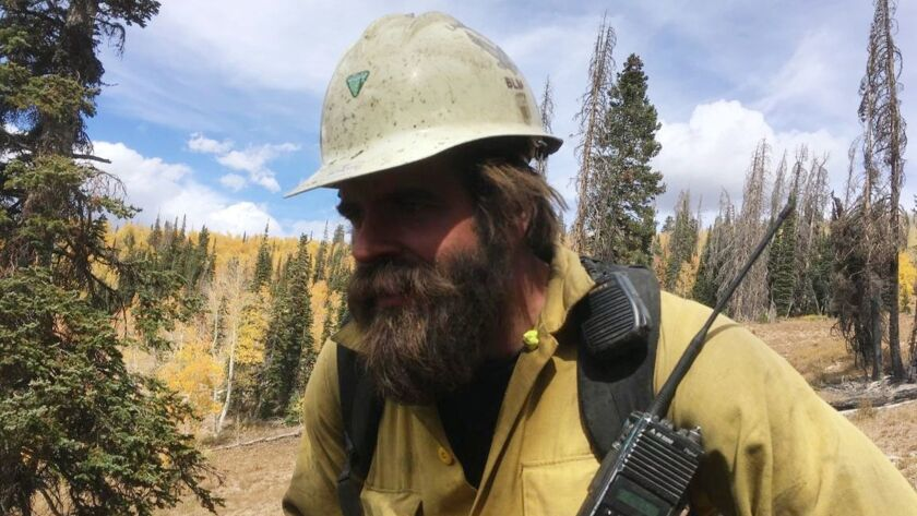 Firefighter Chris Schott at work in Utah this year with his Oregon-based hotshot firefighting crew.