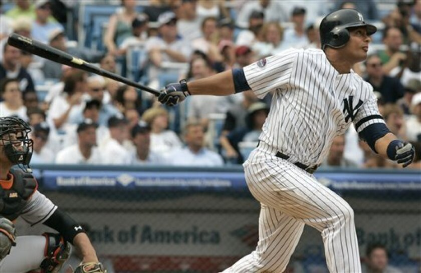 New York Yankees' Bobby Abreu follows through on a home run during the seventh inning of a baseball game against the Baltimore Orioles on Wednesday, July 30, 2008, in New York. The Yankees won 13-3. (AP Photo/Frank Franklin II)