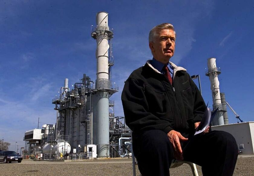 Then-California Gov. Gray Davis waits for the start of a news conference on March 13, 2001, at a cogeneration plant owned by the Sacramento Municipal Utility District.