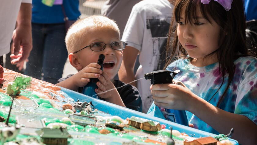 Kids participate with hand-on activities organized by Think Blue San Diego, part of the Stem in Your Backyard countywide events..