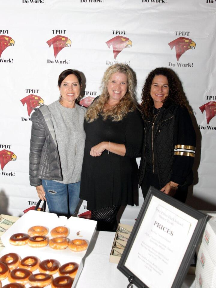 Shelby Wyandt, Angie Austin, and Patti Aardema sell donuts to support the Torrey Pines High School Dance Team