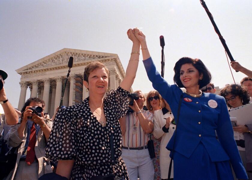 Norma McCorvey and attorney Gloria Allred in 1989